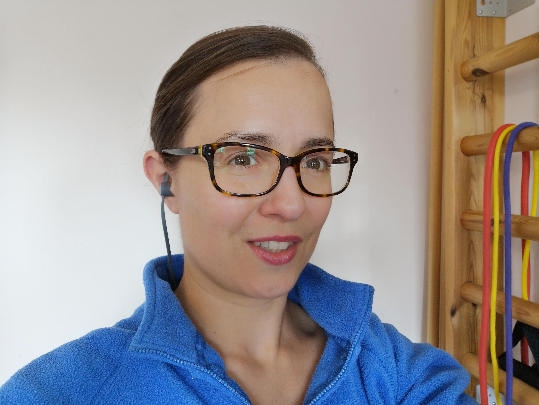 Demonstrating in-ear headphones