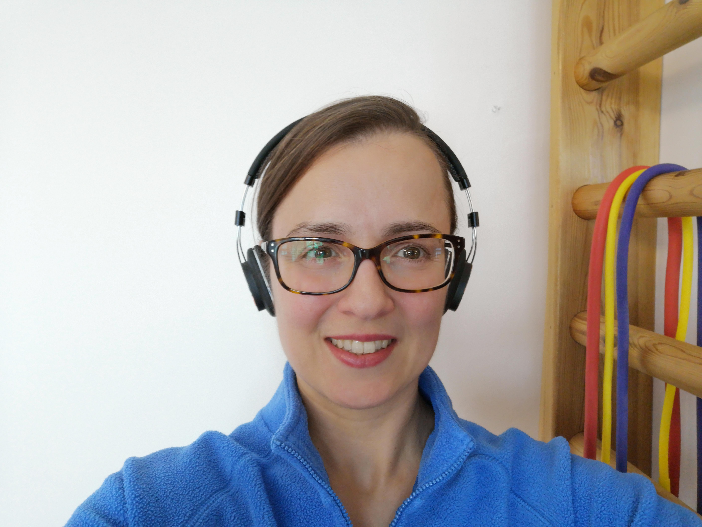 Demonstrating over-ear headphones