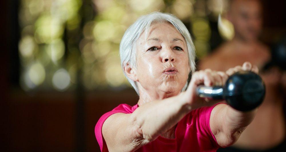 Lady swinging kettlebell